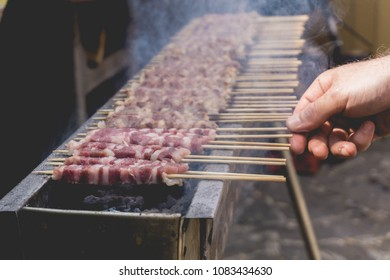 Arrosticini on the grill while turning