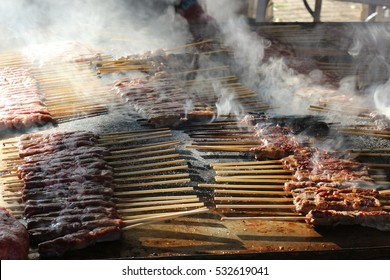 Arrosticini sheep. Italy street food cooked in a street market in Rome, Italy