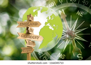 arrow direction on compass and stylized globe background