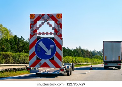 Arrow down right road sign in highway in Poland.