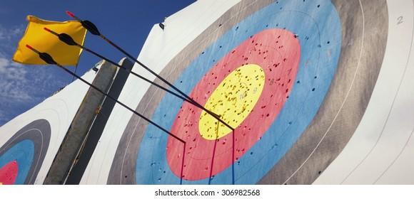 Arrow hit goal ring in archery target the sky