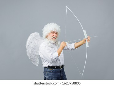 Arrow of love. Cupid throws arrow with bow for valentine day. Male angel with bow and arrow. Cupid angel with bow and arrows. Cupid in valentine day. Valentines Day concept. Valentines day cupid.