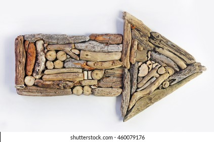 Arrow made from drift wood isolated on white background.