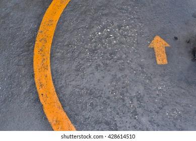 The arrow on the cement