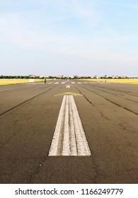 Arrow on old runway pavement.