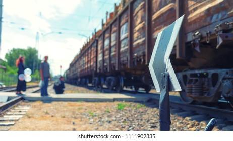 Arrow on the railway crossing