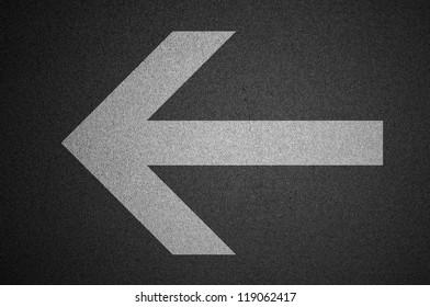 Arrow on road, asphalt