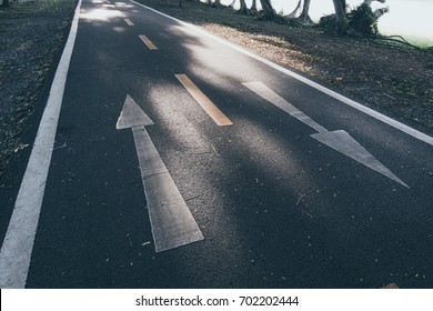 Arrow on road with opposite position