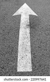 Arrow on the street background