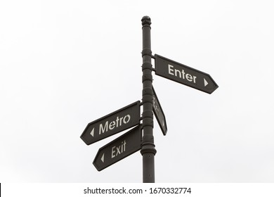 arrow pointer showing directions of entrance and exit from the metro, the road sign is on the street on a white background