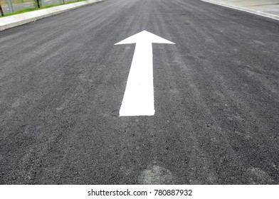 Arrow road marking made from thermoplastic. Signage show direction for the road users.