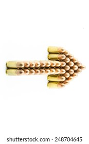 Arrow sight made from bullets on white background.