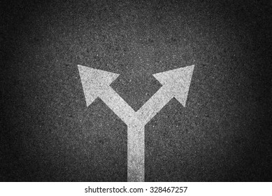 Arrow sign direction on asphalt