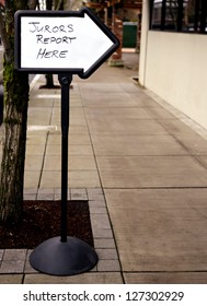 An arrow sign giving directions for Jurors