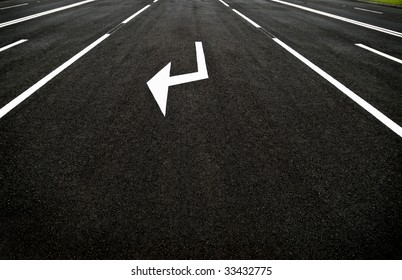 Arrow sign on a highway automobile road