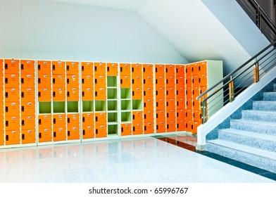 arrow sign on orange lockers
