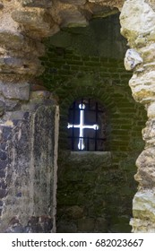 An Arrow Slit in the wall of the 13th century Titchfield Abbey in Hampshire England that was home to a monastic community many centuries ago.