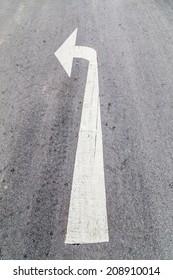 Arrow turn left on street