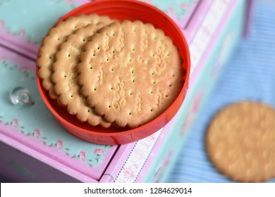 Arrowroot biscuits stacked or arranged in red plate, Kerala, India. Healthy accompaniment with your daily morning cup of tea or coffee or between meal time. Kids favorite biscuit.