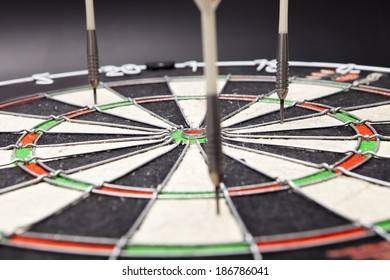 arrows darts hit the target and are shown on a black