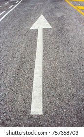 Arrows go straight on the paved road.
