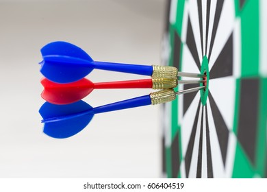 Arrows hitting the center of a target board, concept of partnership