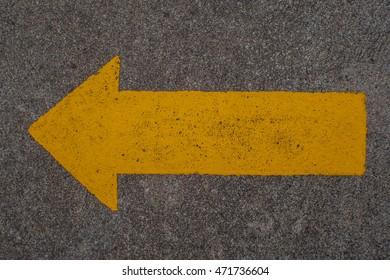 Arrows on asphalt road