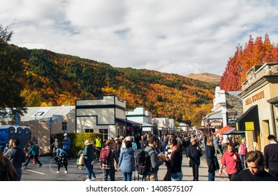 ARROWTOWN, NEW ZEALAND - Apr 27, 2019:  People waiting for Arrowtown Autumn festival Parade in Buckingham street with Autumn landscape background