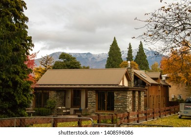 ARROWTOWN, NEW ZEALAND - Apr 27, 2019: A house in Arrowtown with snow mountain background in south island of New Zealand. Shallow DOF.