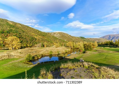 Arrowtown , New Zealand - April 22 , 2017 : Female golfer is playing on Arrowtown Golf course in Autumn , South Island of New Zealand