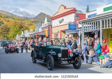 Arrowtown, New Zealand - April 23,2016 : There is parade event during the Arrowtown Autumn Festival on Buckingham Street, people can seen watching and enjoying the parade.