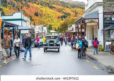 Arrowtown, New Zealand - April 23,2016 : People can seen exploring around the Arrowtown during the Arrowtown Autumn Festival on Buckingham Street.