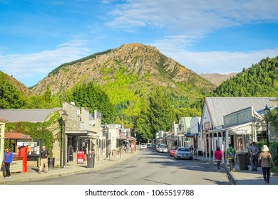 Arrowtown, New Zealand - Feb 22, 2017: Tourists are walking around the main street.