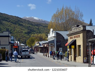 Arrowtown, New Zealand - October 14, 2018; Tourists in the main street of Arrowtown in Spring.