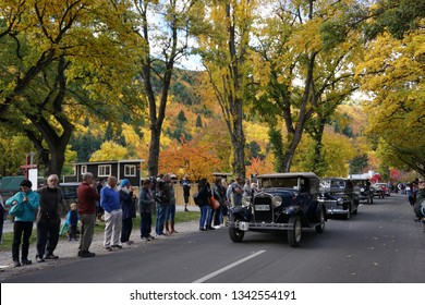 Arrowtown/New Zealand - 23 March 2018 Autumn Festival arrowtown Parade with classic vintage antique car show beautiful yellow orange leaves luxury shiny motor colorful automobile famous new zealand