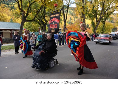 Arrowtown/New Zealand: 23 March 2018: Spanish dancers flamenco beautiful colorful layers dress dancing Arrowtown Autumn Festival Parade traditional Buckingham Belles sexy ladies yellow leaves
