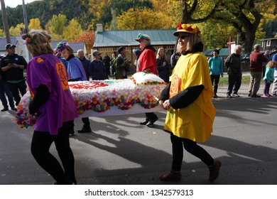 Arrowtown/NewZealand 28 Mar 2018: Arrowtown Autumn festival Parade colorful cars dancers hoop dogs children wear costumes Elizabeth Era New Zealand famous holiday yellow beautiful leaves carnival