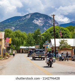 ARROYO SECO, NM, USA-12 JULY 18:   The main street of this small artsy, tourist village near Taos, is dwarfed by part of the Sangre de Cristo mountains.