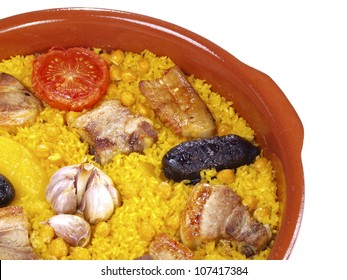 Arroz al Horno � Oven cooked rice. The �Arroz al Horno� is a simple but delicious recipe with rice, chickpeas, pork ribs, black sausage, bacon, potatoes, tomatoes, and garlic, cooked into the oven.