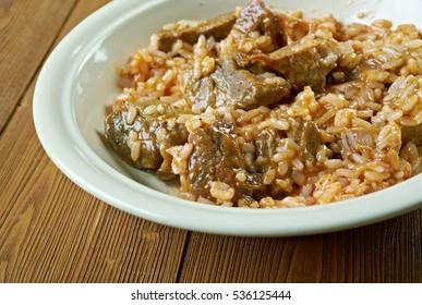 arroz de cabidela  -  Portuguese dish made with rabbit .