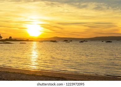 Arruda cape in Arousa Island at golden sunset from Espineiro beach