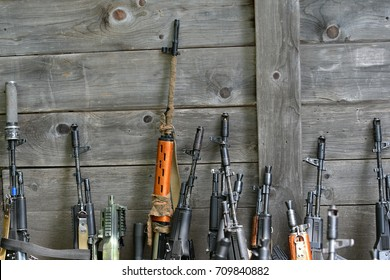 Arsenal of weapons collection, close-up of guns and grips. firearms , AK-47, Russian Kalashnikov