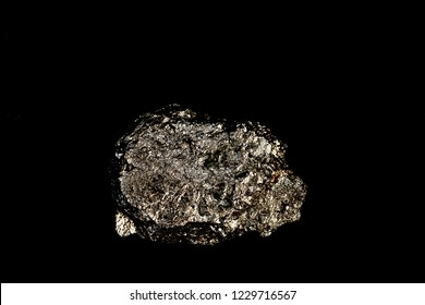 Arsenopyrite, isolated, on a black background.Arsenopyrite is a common mineral, an industrial source of arsenic and a useful component of complex ores.