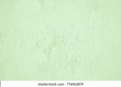 Art Abstract Grunge Decorative Light Green Painted Wall Texture. Rough Plaster Background. Horizontal Wallpaper With Copy Space For design