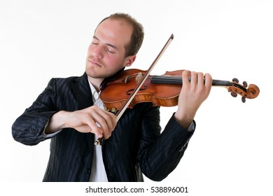Art and artist. Young elegant man violinist fiddler playing violin isolated on black background. Classical music. Studio shot.