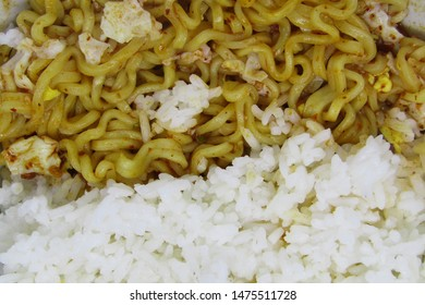 Art background blurred. Close up view hot warm wavy textured stack heap pile yellow brown gold color of mie mee goreng dry base drain served on plate cooked tasty, thick like hair heap pile vast frame
