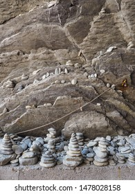 The art of balancing stones or rock stacking. A stone cairn is human-made pile of stones stacked on top of each other. People stacking them as a way to relax, relieve stress, meditate, create and play