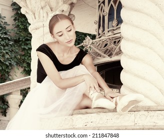 Art ballet. Beautiful young ballerina posing on emotional nature. Marble interior. Original unusual positions.