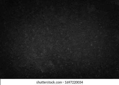 Art black concrete stone texture for background in black. Abstract color dry scratched surface wall cover colorful paper scratches shabby vintage Cement and sand grey dark detail covering.