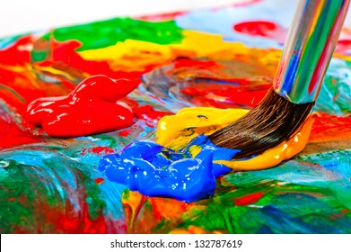 Art brush mixed paint on the palette